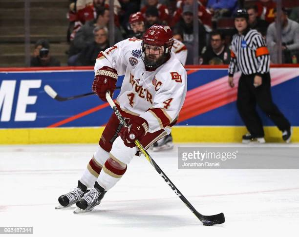 Will Butcher of the Denver Pioneers looks to pass against the Notre Dame Fighting Irish during game two of the 2017 NCAA Division I Men's Hockey...