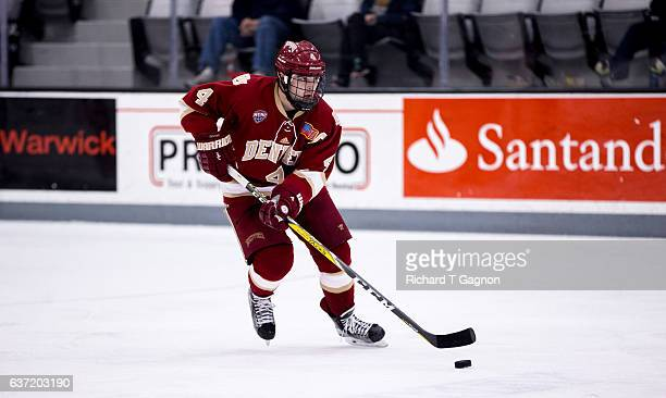 Will Butcher of the Denver Pioneers skates against the Providence College Friars during NCAA hockey at the Schneider Arena on December 30 2016 in...