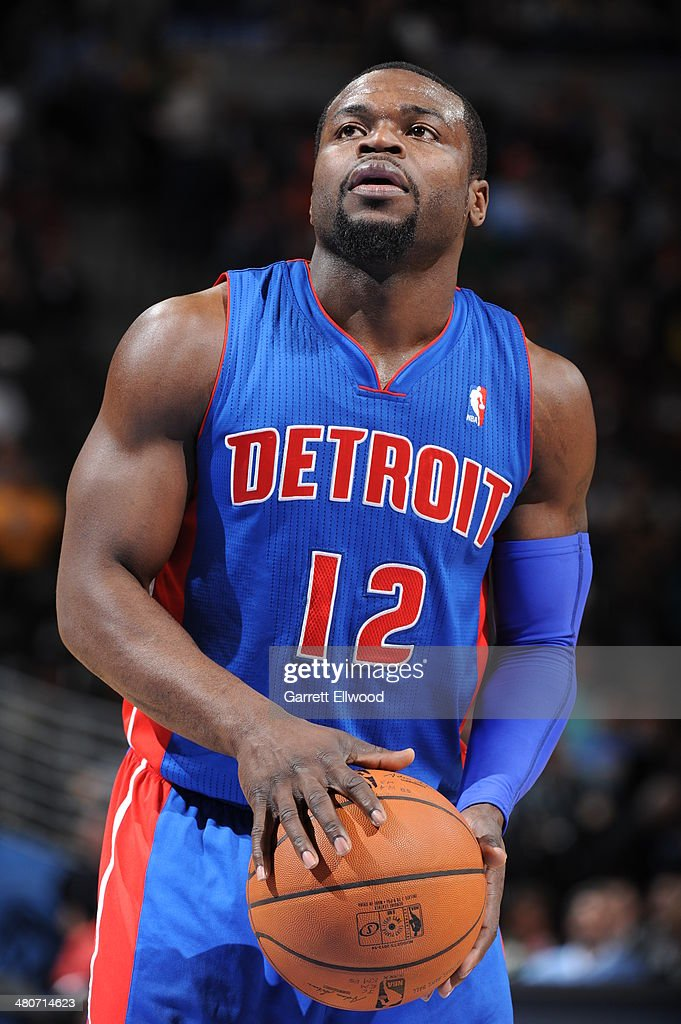 <a gi-track='captionPersonalityLinkClicked' href=/galleries/search?phrase=Will+Bynum&family=editorial&specificpeople=212891 ng-click='$event.stopPropagation()'>Will Bynum</a> #12 of the Detroit Pistons attempts a free throw against the Denver Nuggets on March 19, 2014 at the Pepsi Center in Denver, Colorado.