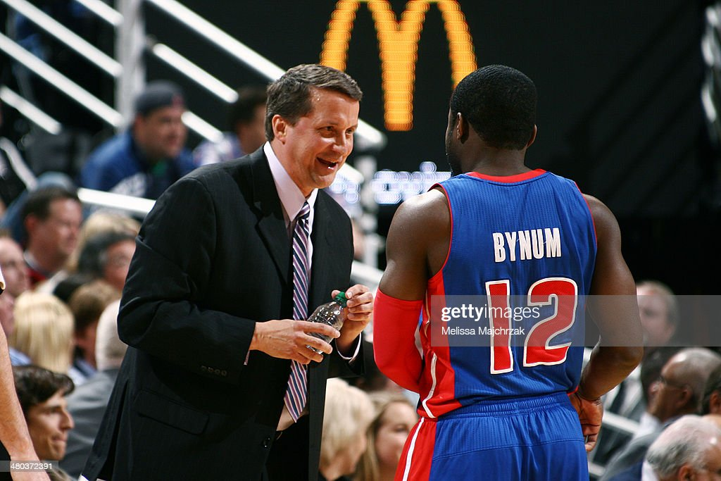 Will Bynum #12 of the Detroit Pistons confers with Pistons' Head Coach John Loyer at EnergySolutions Arena on March 24, 2014 in Salt Lake City, Utah.