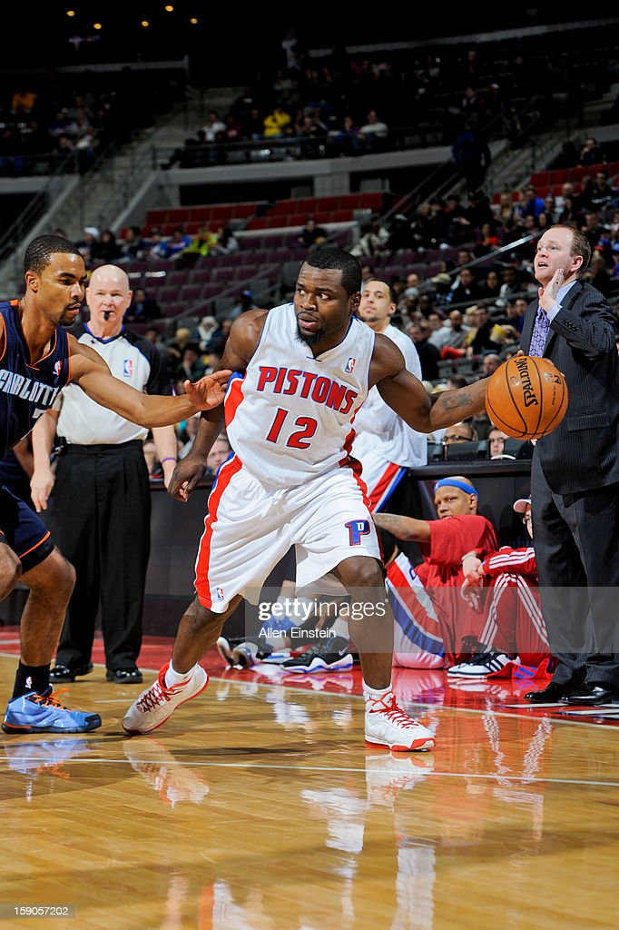 Will Bynum #12 of the Detroit Pistons controls the ball as head coach Lawrence Frank calls out a play against the Charlotte Bobcats on January 6, 2013 at The Palace of Auburn Hills in Auburn Hills, Michigan.