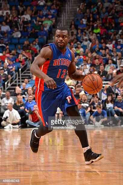 Will Bynum of the Detroit Pistons dribbles up the court against the Orlando Magic during the game on December 27 2013 at Amway Center in Orlando...