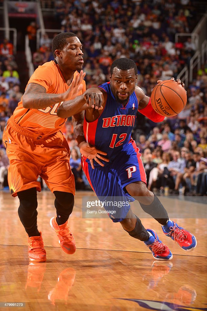 Will Bynum #12 of the Detroit Pistons drives against Eric Bledsoe #2 of the Phoenix Suns on March 21, 2014 at U.S. Airways Center in Phoenix, Arizona.