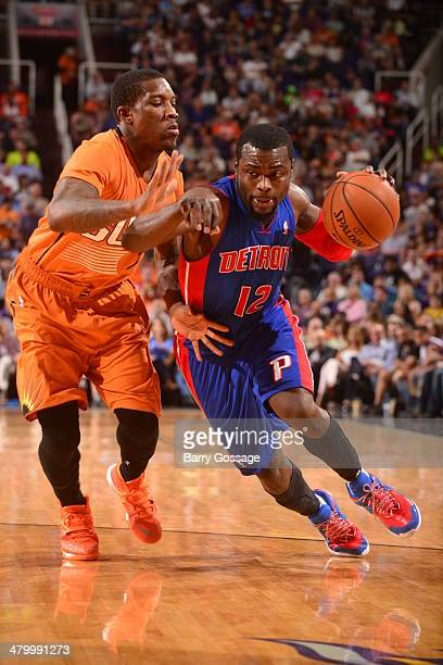 Will Bynum of the Detroit Pistons drives against Eric Bledsoe of the Phoenix Suns on March 21 2014 at US Airways Center in Phoenix Arizona NOTE TO...