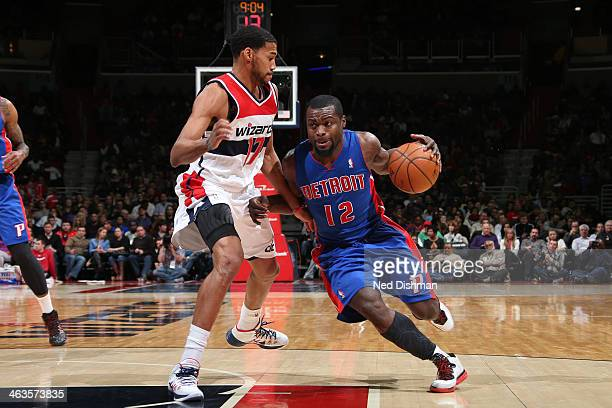 Will Bynum of the Detroit Pistons drives against Garrett Temple of the Washington Wizards during the game at the Verizon Center on January 18 2014 in...