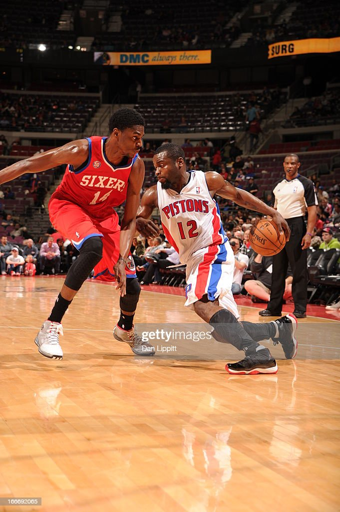Will Bynum #12 of the Detroit Pistons drives against Justin Holiday #14 of the Philadelphia 76ers during the game between the Detroit Pistons and the Philadelphia 76ers on April 15, 2013 at The Palace of Auburn Hills in Auburn Hills, Michigan.