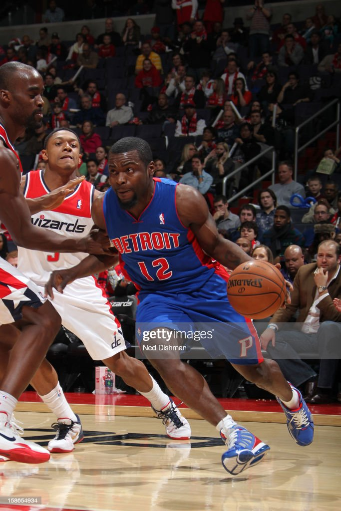 <a gi-track='captionPersonalityLinkClicked' href=/galleries/search?phrase=Will+Bynum&family=editorial&specificpeople=212891 ng-click='$event.stopPropagation()'>Will Bynum</a> #12 of the Detroit Pistons drives to the basket against <a gi-track='captionPersonalityLinkClicked' href=/galleries/search?phrase=Emeka+Okafor&family=editorial&specificpeople=201739 ng-click='$event.stopPropagation()'>Emeka Okafor</a> #50 and <a gi-track='captionPersonalityLinkClicked' href=/galleries/search?phrase=Bradley+Beal&family=editorial&specificpeople=7640439 ng-click='$event.stopPropagation()'>Bradley Beal</a> #3 of the Washington Wizards during the game at the Verizon Center on December 22, 2012 in Washington, DC.