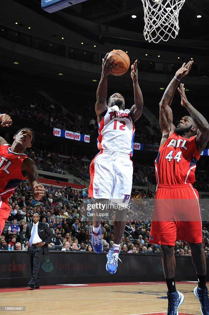 Will Bynum #12 of the Detroit Pistons drives to the basket against Ivan Johnson #44 of the Atlanta Hawks on January 4, 2013 at The Palace of Auburn Hills in Auburn Hills, Michigan.
