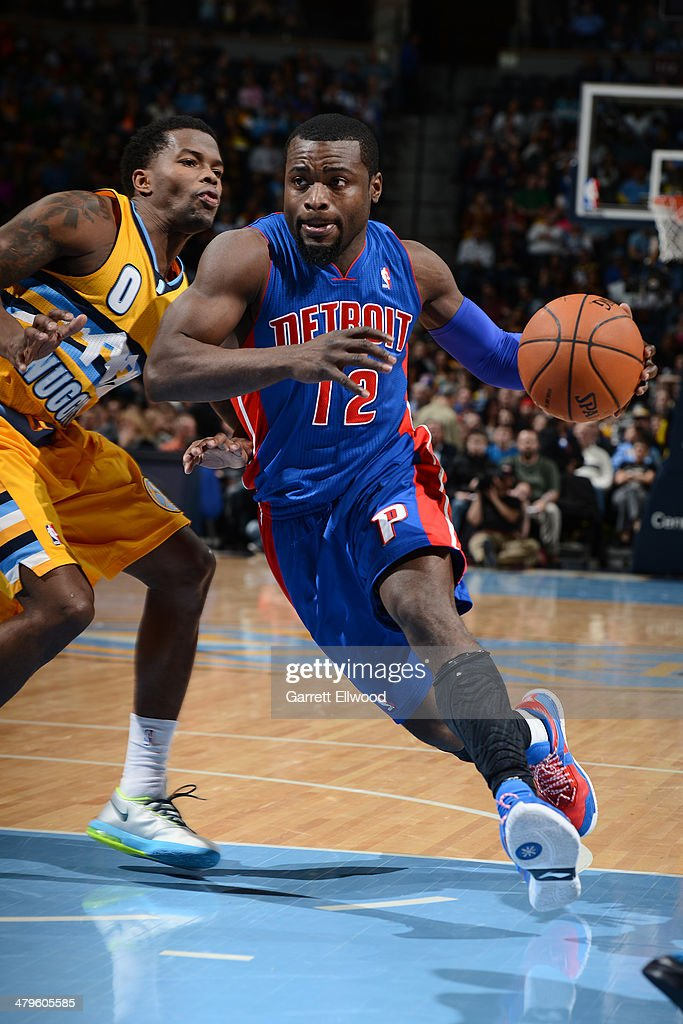 Will Bynum #12 of the Detroit Pistons drives to the basket against the Denver Nuggets on March 19, 2014 at the Pepsi Center in Denver, Colorado.