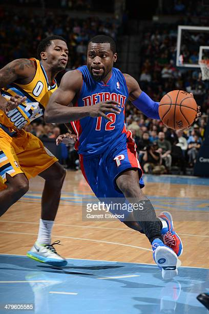 Will Bynum of the Detroit Pistons drives to the basket against the Denver Nuggets on March 19 2014 at the Pepsi Center in Denver Colorado NOTE TO...