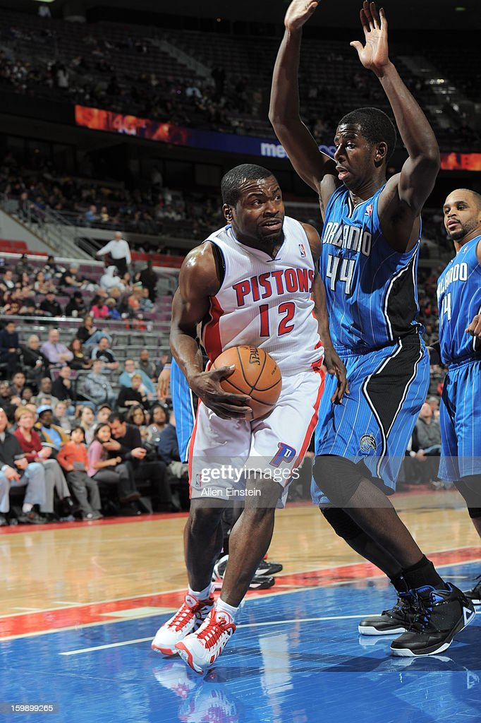 Will Bynum #12 of the Detroit Pistons goes to the basket against Andrew Nicholson #44 of the Orlando Magic on January 22, 2013 at The Palace of Auburn Hills in Auburn Hills, Michigan.