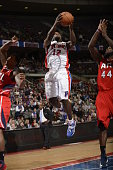 Will Bynum of the Detroit Pistons goes to the basket against Ivan Johnson of the Atlanta Hawks during the game on January 4 2013 at The Palace of...