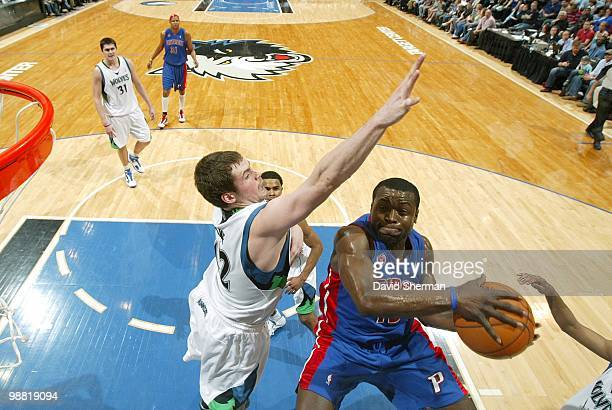 Will Bynum of the Detroit Pistons goes up for a layup against Kevin Love of the Minnesota Timberwolves during the game at Target Center on April 14...