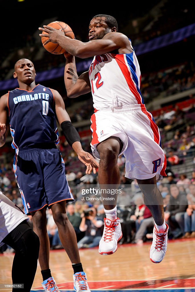 <a gi-track='captionPersonalityLinkClicked' href=/galleries/search?phrase=Will+Bynum&family=editorial&specificpeople=212891 ng-click='$event.stopPropagation()'>Will Bynum</a> #12 of the Detroit Pistons looks to pass the ball against <a gi-track='captionPersonalityLinkClicked' href=/galleries/search?phrase=Bismack+Biyombo&family=editorial&specificpeople=7640443 ng-click='$event.stopPropagation()'>Bismack Biyombo</a> #0 of the Charlotte Bobcats on January 6, 2013 at The Palace of Auburn Hills in Auburn Hills, Michigan.