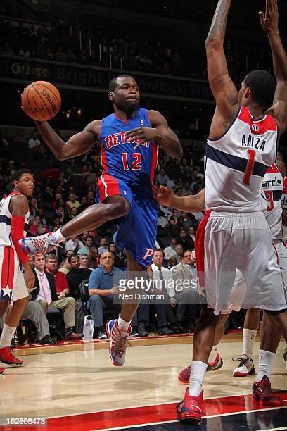 Will Bynum of the Detroit Pistons passes the ball against Trevor Ariza of the Washington Wizards during the game at the Verizon Center on February 27...