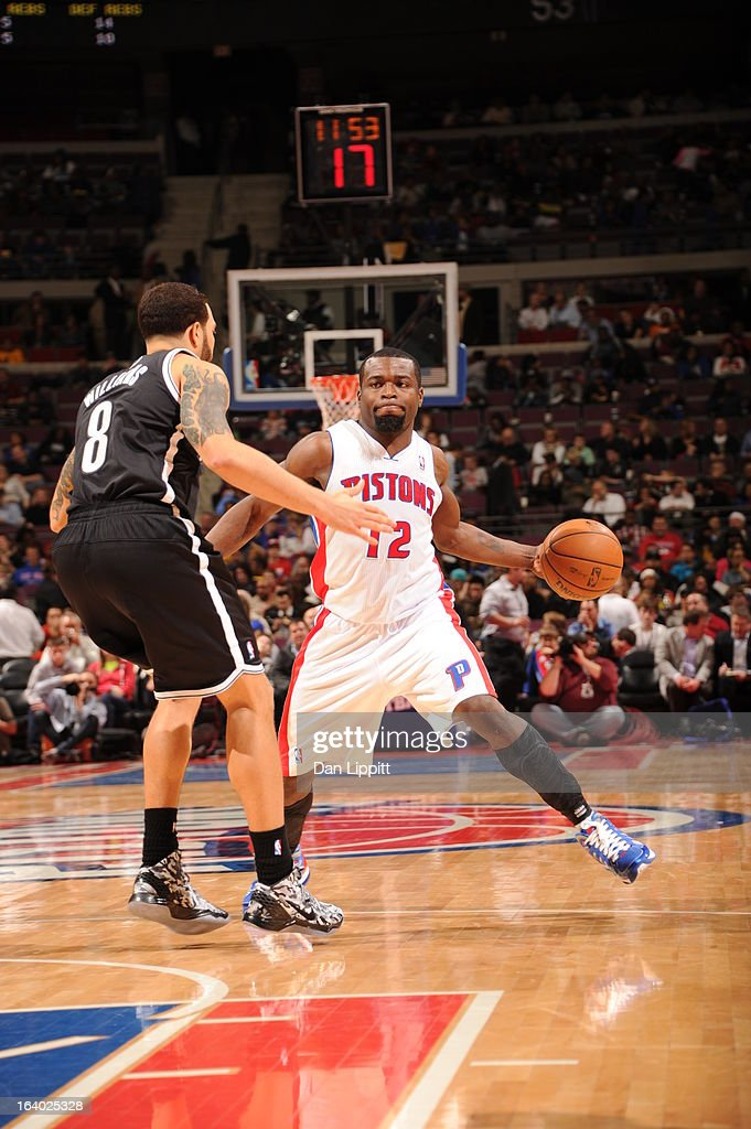 Will Bynum #12 of the Detroit Pistons passes the ball down low against Deron Williams #8 of the Brooklyn Nets on March 18, 2013 at The Palace of Auburn Hills in Auburn Hills, Michigan.