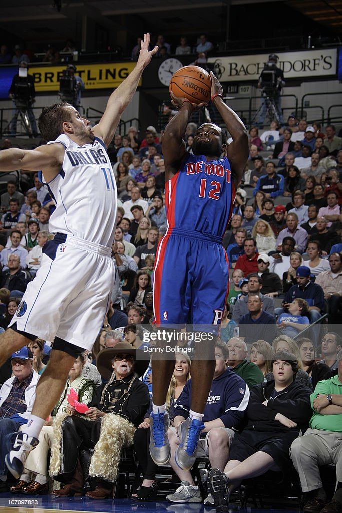 Will Bynum #12 of the Detroit Pistons shoots a jumper against Jose Juan Barea #11 of the Dallas Mavericks during a game on November 23, 2010 at the American Airlines Center in Dallas, Texas.