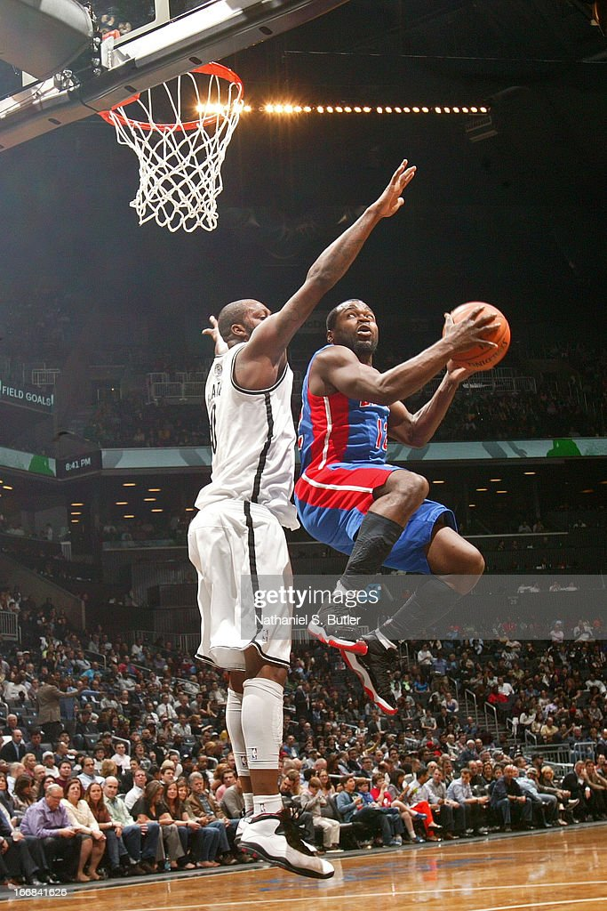 Will Bynum #12 of the Detroit Pistons shoots against Andray Blatche #0 of the Brooklyn Netson April 17, 2013 at the Barclays Center in the Brooklyn borough of New York City.