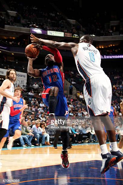 Will Bynum of the Detroit Pistons shoots against Bismack Biyombo of the Charlotte Bobcats at the Time Warner Cable Arena on February 19 2014 in...