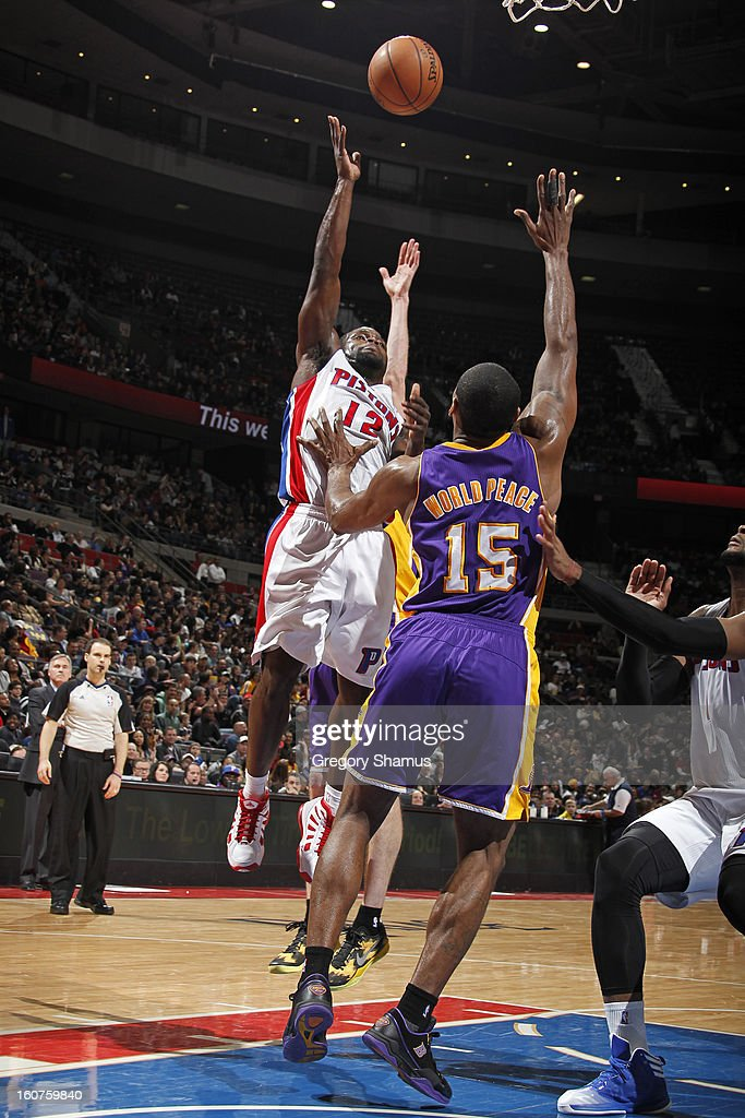 Will Bynum #12 of the Detroit Pistons shoots against Metta World Peace #15 of the Los Angeles Lakers on February 3, 2013 at The Palace of Auburn Hills in Auburn Hills, Michigan.