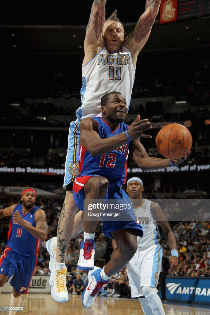 Will Bynum #12 of the Detroit Pistons tries to layup a shot under the defense of Chris Andersen #11 of the Denver Nuggets at the Pepsi Center on March 12, 2011 in Denver, Colorado.