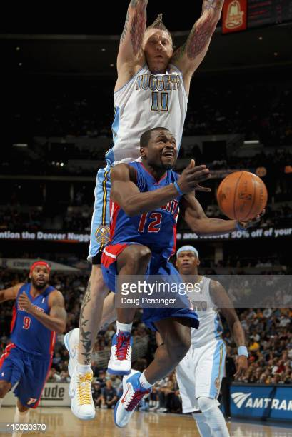 Will Bynum of the Detroit Pistons tries to layup a shot under the defense of Chris Andersen of the Denver Nuggets at the Pepsi Center on March 12...