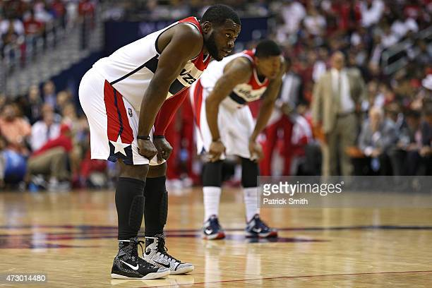 Will Bynum of the Washington Wizards and teammate Bradley Beal look on against the Atlanta Hawks during the second half in Game Four of the Eastern...
