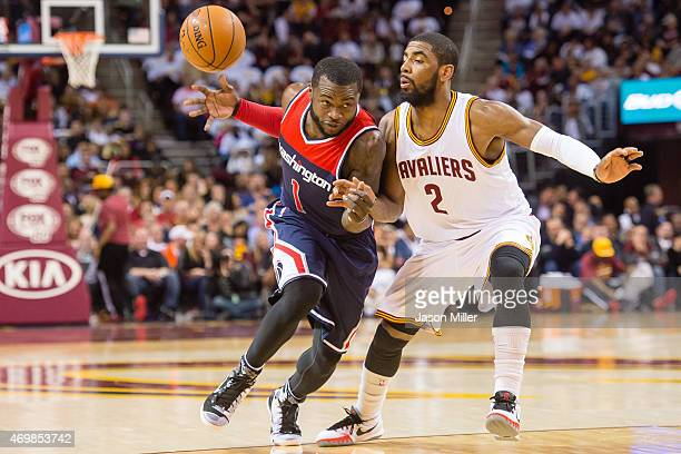 Will Bynum of the Washington Wizards loses the ball as he tries to drive around Kyrie Irving of the Cleveland Cavaliers during the first half at...