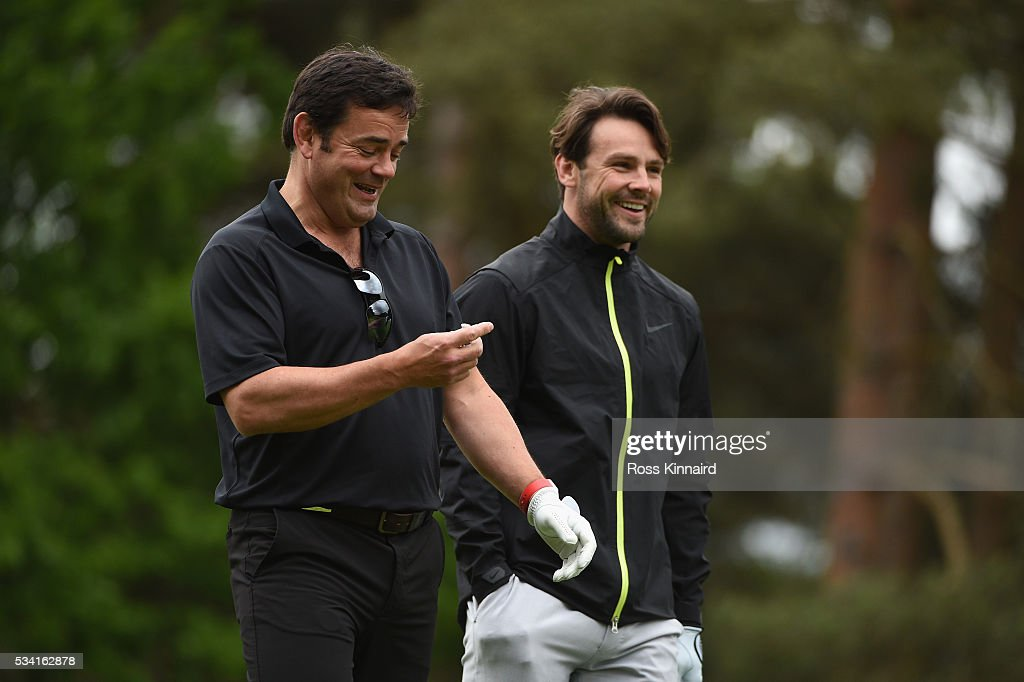 <a gi-track='captionPersonalityLinkClicked' href=/galleries/search?phrase=Will+Carling&family=editorial&specificpeople=67233 ng-click='$event.stopPropagation()'>Will Carling</a> and <a gi-track='captionPersonalityLinkClicked' href=/galleries/search?phrase=Ben+Foden&family=editorial&specificpeople=542798 ng-click='$event.stopPropagation()'>Ben Foden</a> during the Pro-Am prior to the BMW PGA Championship at Wentworth on May 25, 2016 in Virginia Water, England.