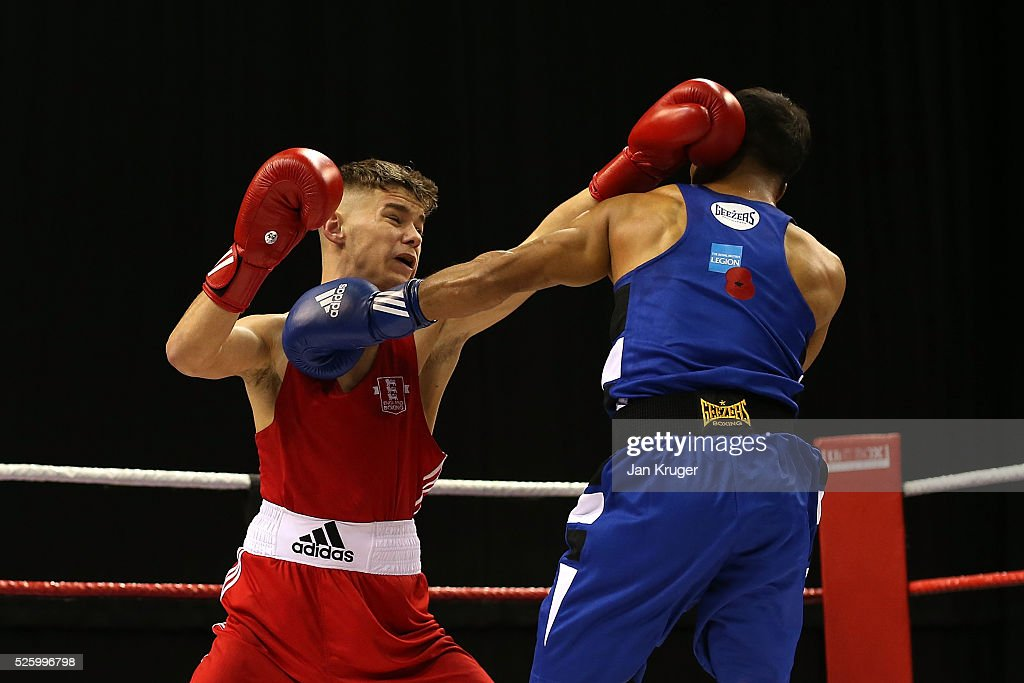 Will Cawley(red) in action against Shamim Khan in their 52kg fight during day one of the Boxing Elite National Championships at Echo Arena on April 29, 2016 in Liverpool, England.