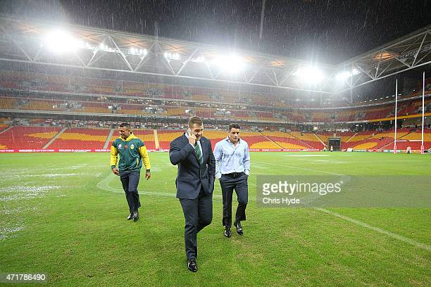 Will Chamber Trent Merrin and Cooper Cronk inspect the field before the TransTasman Test match between the Australia Kangaroos and the New Zealand...