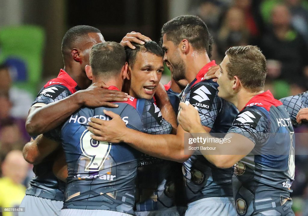 Will Chambers of the Melbourne Storm is congratulated by his teammates after scoring the second try of the match during the round five NRL match between the Melbourne Storm and the Penrith Panthers at AAMI Park on April 1, 2017 in Melbourne, Australia.