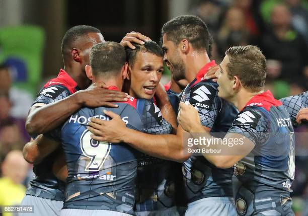 Will Chambers of the Melbourne Storm is congratulated by his teammates after scoring the second try of the match during the round five NRL match...