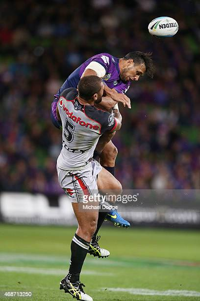 Will Chambers of the Storm and Manu Vatuvei of the Warriors compete for the ball during the round five NRL match between the Melbourne Storm and the...