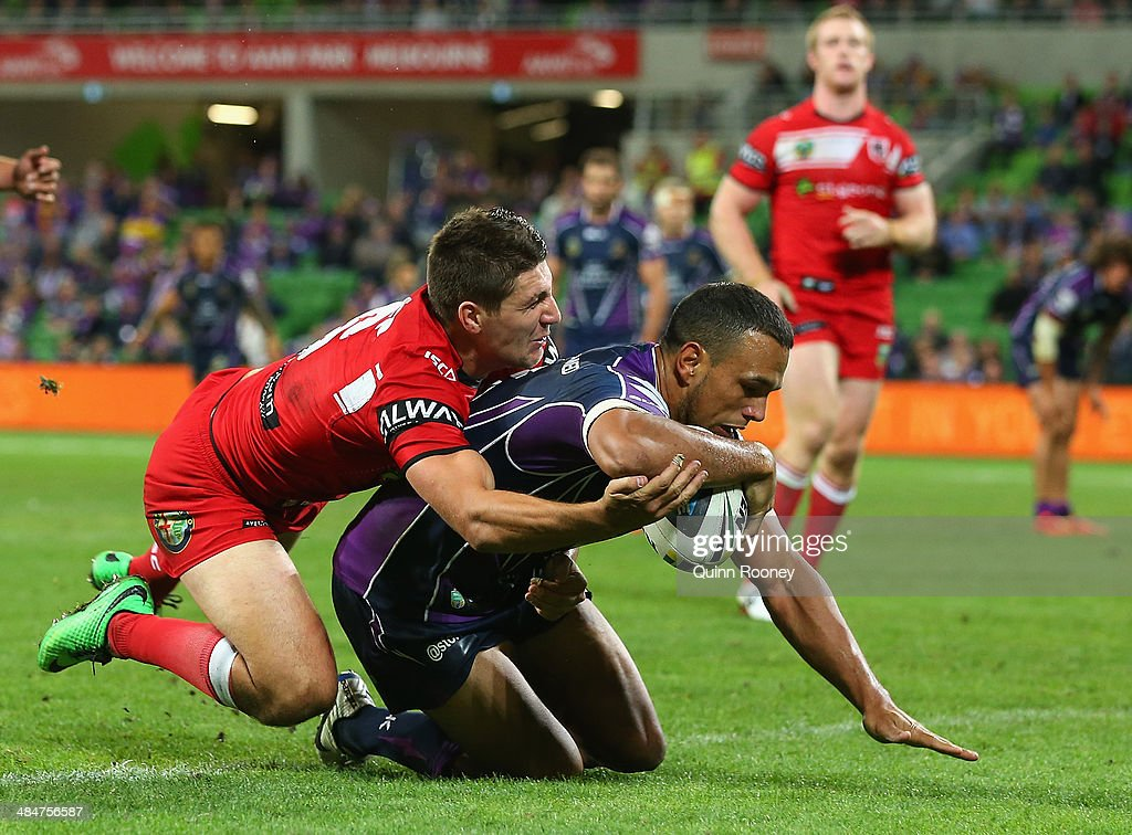 Will Chambers of the Storm breaks through a tackle by Gareth Widdop of the Dragons to score a try during the round 6 NRL match between the Melbourne Storm and the St George Illawarra Dragons at AAMI Park on April 14, 2014 in Melbourne, Australia.