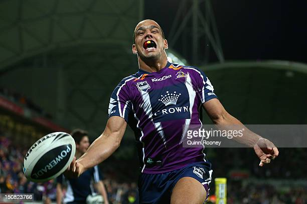 Will Chambers of the Storm celebrates scoring a try to win the game during the round 25 NRL match between the Melbourne Storm and the Cronulla Sharks...