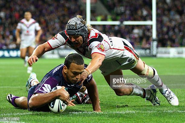 Will Chambers of the Storm crosses the line to score a try during the round seven NRL match between the Melbourne Storm and the New Zealand Warriors...