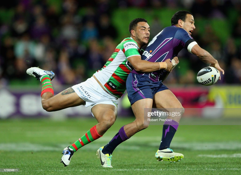 <a gi-track='captionPersonalityLinkClicked' href=/galleries/search?phrase=Will+Chambers&family=editorial&specificpeople=4290838 ng-click='$event.stopPropagation()'>Will Chambers</a> of the Storm is tackled by Dylan Farrell of the Rabbitohs during the round 22 NRL match between the Melbourne Storm and the South Sydney Rabbitohs at AAMI Park on August 9, 2013 in Melbourne, Australia.