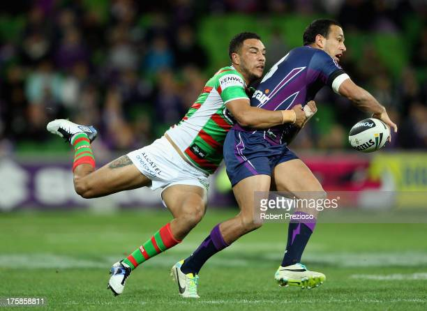 Will Chambers of the Storm is tackled by Dylan Farrell of the Rabbitohs during the round 22 NRL match between the Melbourne Storm and the South...