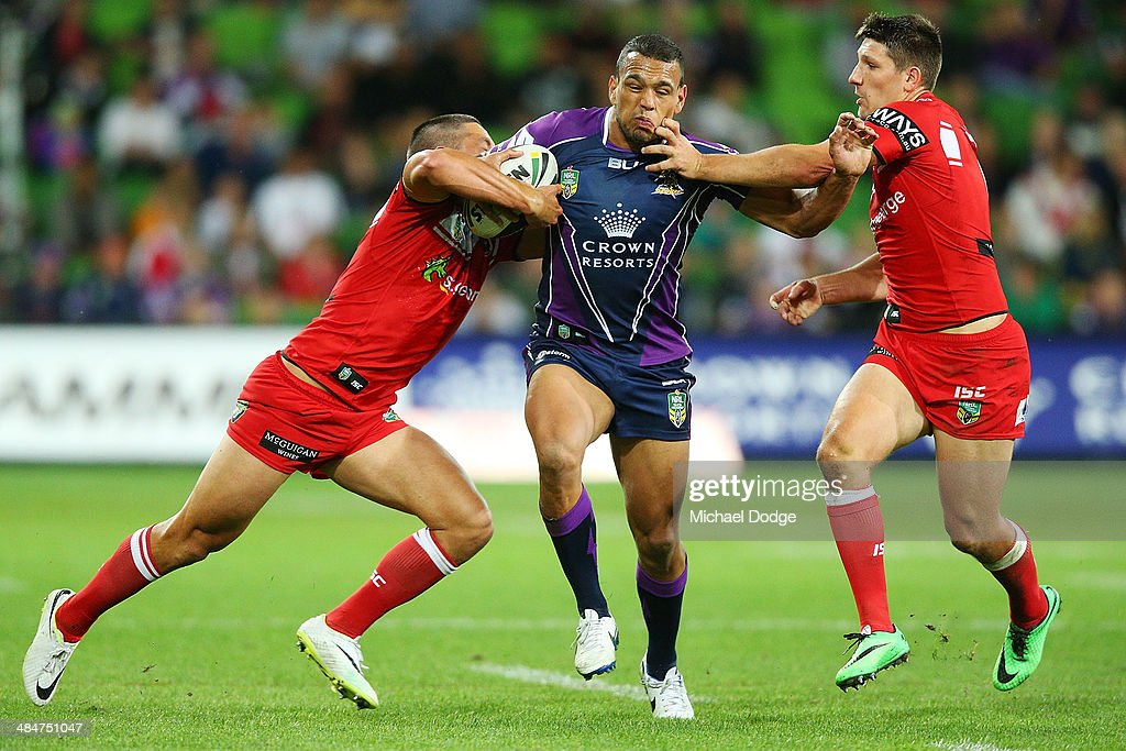 Will Chambers of the Storm is tackled by Gerard Beale (L) and Gareth Widdop of the Dragons during the round 6 NRL match between the Melbourne Storm and the St George Illawarra Dragons at AAMI Park on April 14, 2014 in Melbourne, Australia.