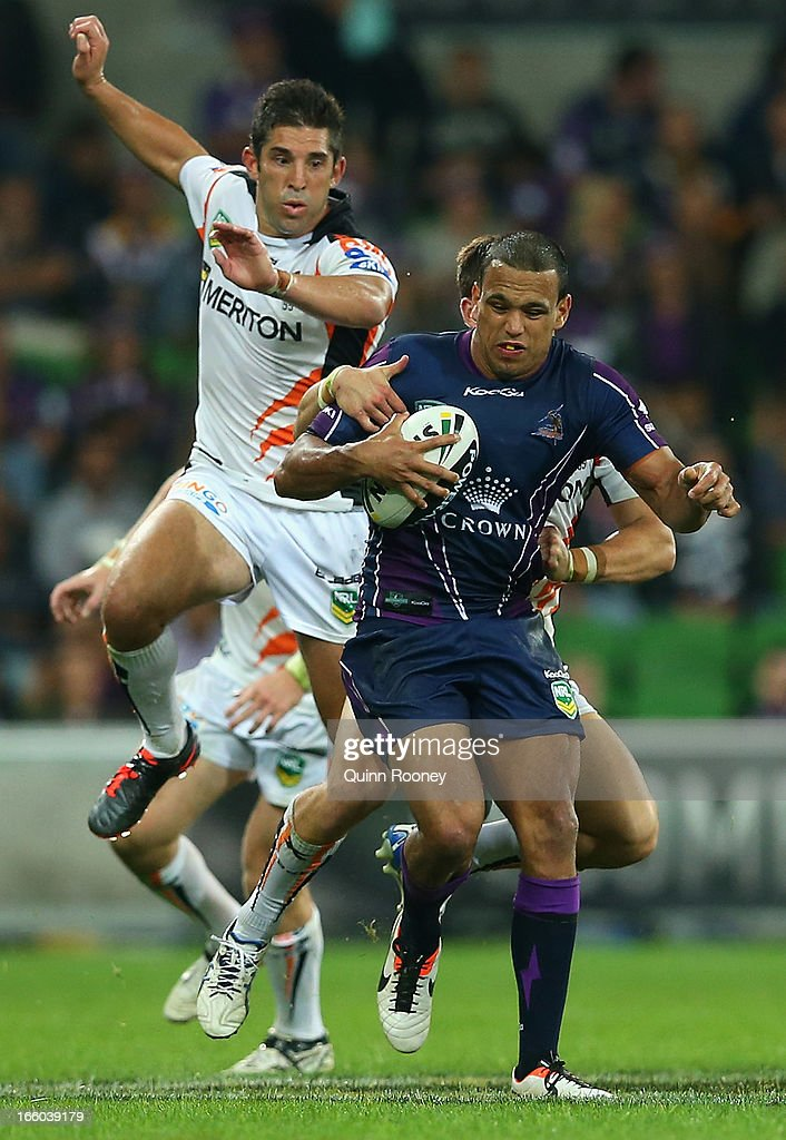 Will Chambers of the Storm is tackled by Tim Moltzen of the Tigers during the round 5 NRL match between the Melbourne Storm and the Wests Tigers at AAMI Stadium on April 8, 2013 in Adelaide, Australia.