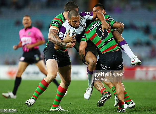 Will Chambers of the Storm is tackled during the NRL Qualifying match between the South Sydney Rabbitohs and the Melbourne Storm at ANZ Stadium on...