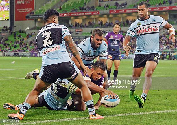 Will Chambers of the Storm scores a try during the round three NRL match between the Melbourne Storm and the Cronulla Sharks at AAMI Park on March 21...
