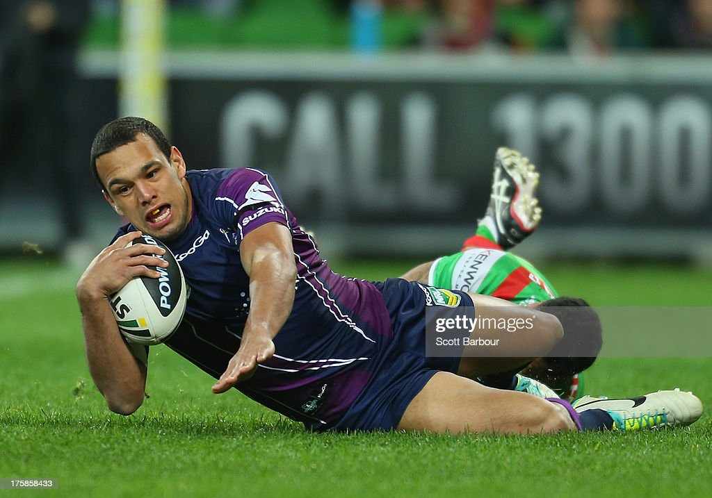 <a gi-track='captionPersonalityLinkClicked' href=/galleries/search?phrase=Will+Chambers&family=editorial&specificpeople=4290838 ng-click='$event.stopPropagation()'>Will Chambers</a> of the Storm scores the first try of the match during the round 22 NRL match between the Melbourne Storm and the South Sydney Rabbitohs at AAMI Park on August 9, 2013 in Melbourne, Australia.