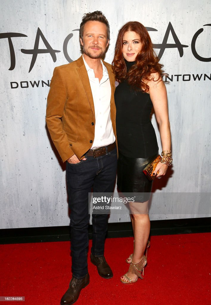 Will Chase (L) and <a gi-track='captionPersonalityLinkClicked' href=/galleries/search?phrase=Debra+Messing&family=editorial&specificpeople=202114 ng-click='$event.stopPropagation()'>Debra Messing</a> attend TAO Downtown Grand Opening on September 28, 2013 in New York City.