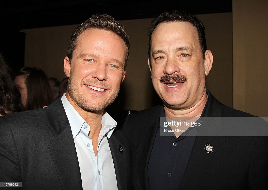 Will Chase and <a gi-track='captionPersonalityLinkClicked' href=/galleries/search?phrase=Tom+Hanks&family=editorial&specificpeople=201790 ng-click='$event.stopPropagation()'>Tom Hanks</a> attend the 2013 Tony Awards: The Meet The Nominees Press Junket at the Millenium Hilton on May 1, 2013 in New York City.