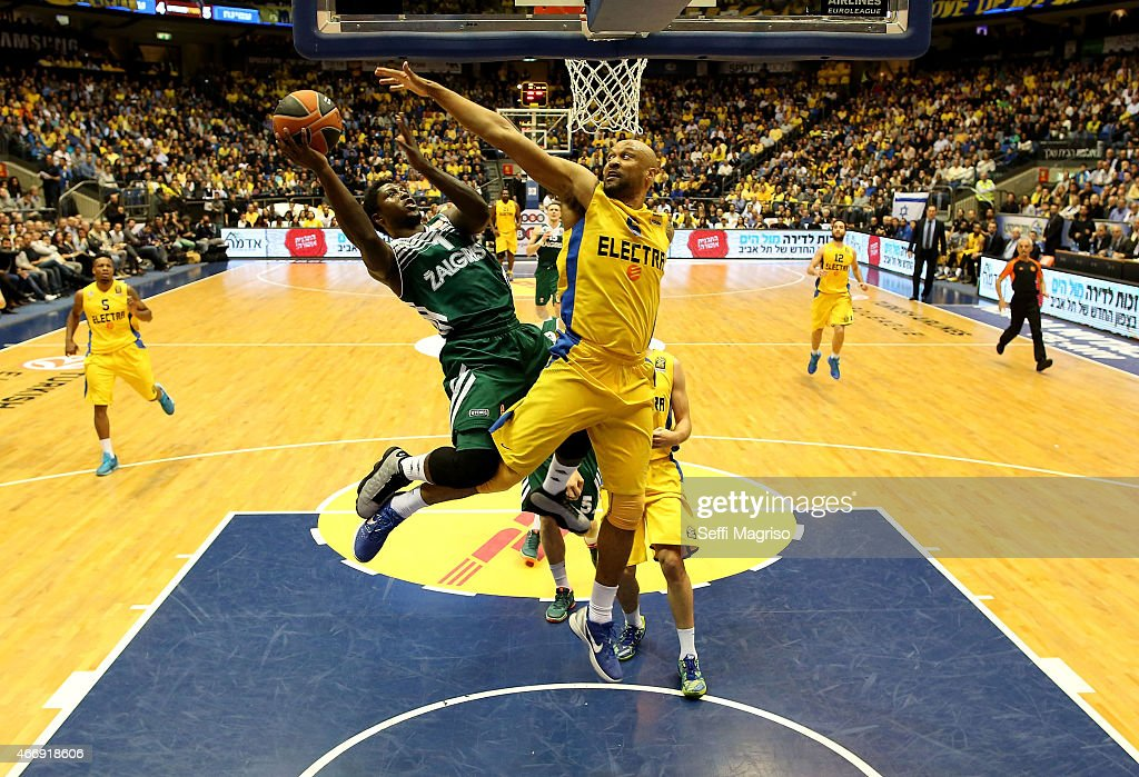 Will Cherry, #1 of Zalgiris Kaunas competes with Devin Smith, #6 of Maccabi Electra Tel Aviv during the Turkish Airlines Euroleague Basketball Top 16 Date 11 game between Maccabi Electra Tel Aviv v Zalgiris Kaunas at Menora Mivtachim Arena on March 19, 2015 in Tel Aviv, Israel.