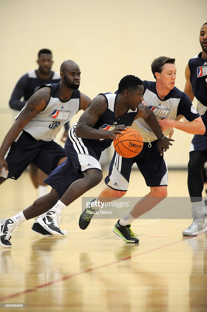 Will Cherry #2 of the Canton Charge moves the ball up court past <a gi-track='captionPersonalityLinkClicked' href=/galleries/search?phrase=Josh+Magette&family=editorial&specificpeople=11644707 ng-click='$event.stopPropagation()'>Josh Magette</a> #4 of the Los Angeles D-Fenders on day two of the 2014 NBA Development League Elite Mini Camp on May 13, 2014 at Quest Multisport in Chicago, Illinois.