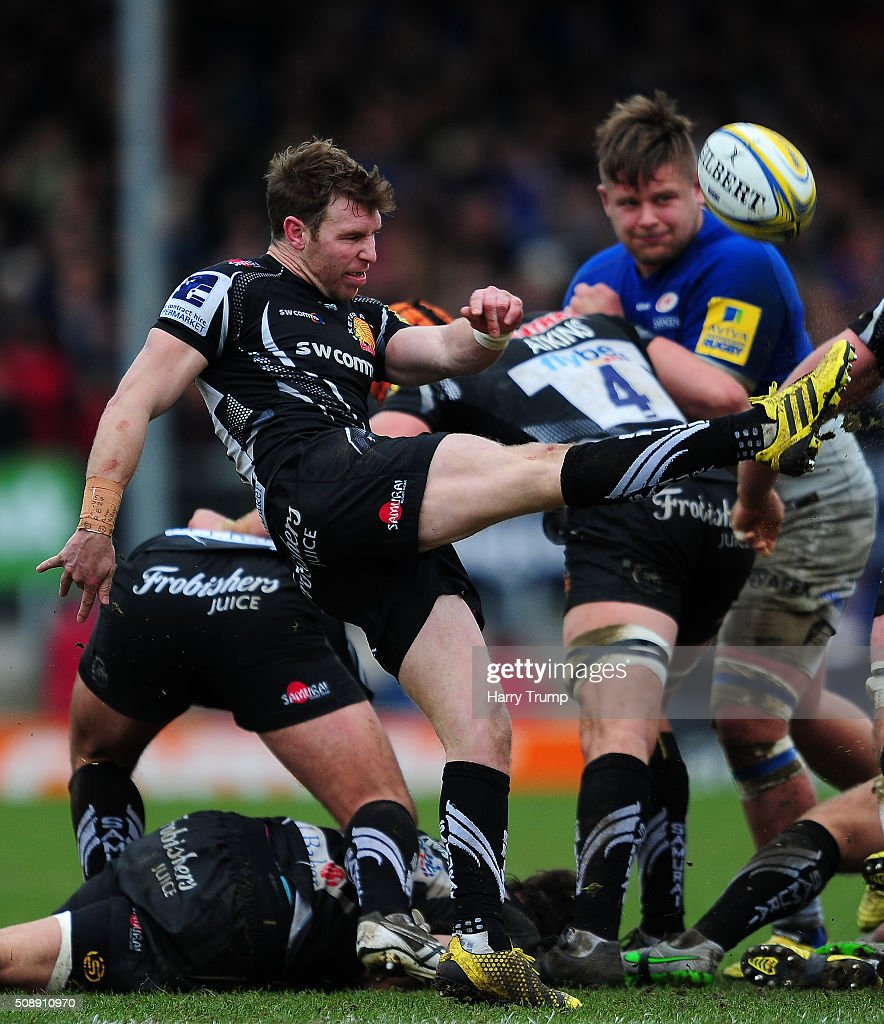 Will Chudley of Exeter Chiefs attempts to clear the ball during the Aviva Premiership match between Exeter Chiefs and Saracens at Sandy Park on February 7, 2016 in Exeter, England.