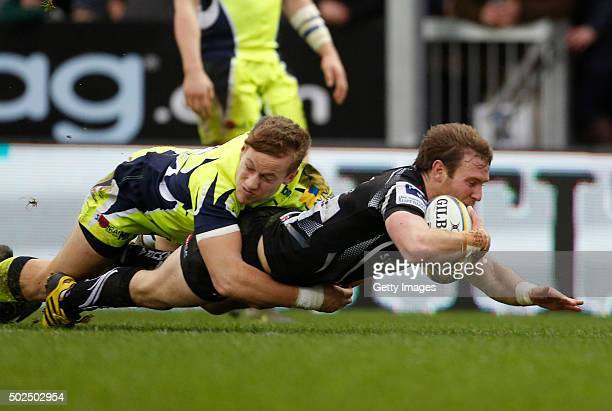 Will Chudley of Exeter Chiefs avoids Mike Haley of the Sale Sharks as he scores a try during the Exeter Chiefs v Sale sharks Aviva Premiership Match...